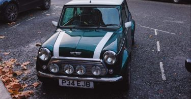 teal and white Mini Cooper parked on parking lot